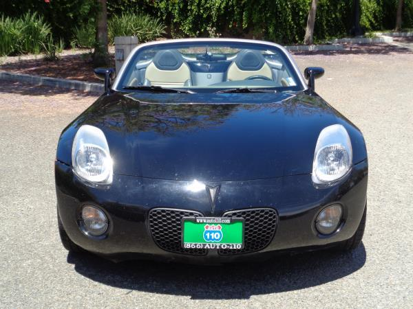 2006 PONTIAC SOLSTICE blackbeige 5 speed manual acabs alloy wheelsamfm stereocd playerco