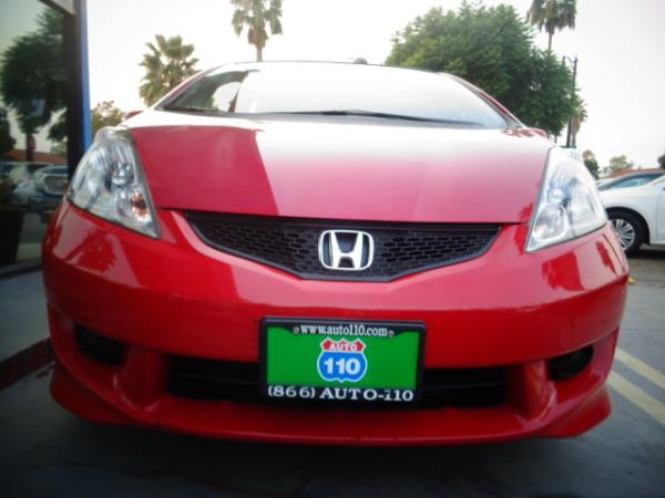 2009 HONDA FIT red 5 speed automatic 97320 miles Stock 2447 VIN JHMGE884X9S059711