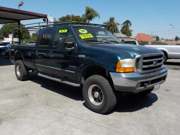1999 FORD F350 CREW CAB 4WD greentan auto air conditioneralarmamfm radioanti-lock brakescd