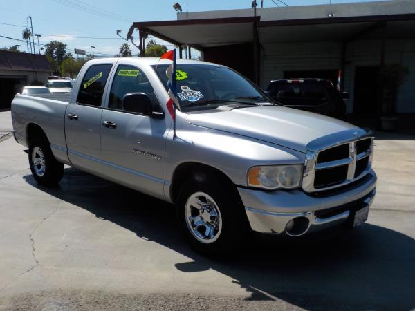 2003 DODGE RAM 1500 QUAD CAB silvertan auto air conditioneralarmamfm radioanti-lock brakes