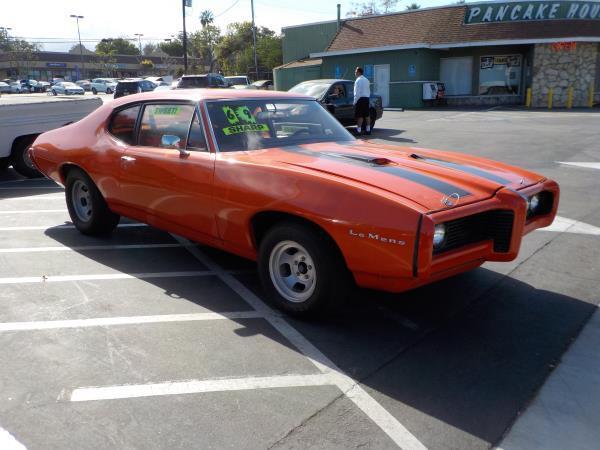 1969 PONTIAC LE MANS orange auto amfm radiopower steeringtinted windows 0 miles Stock 818