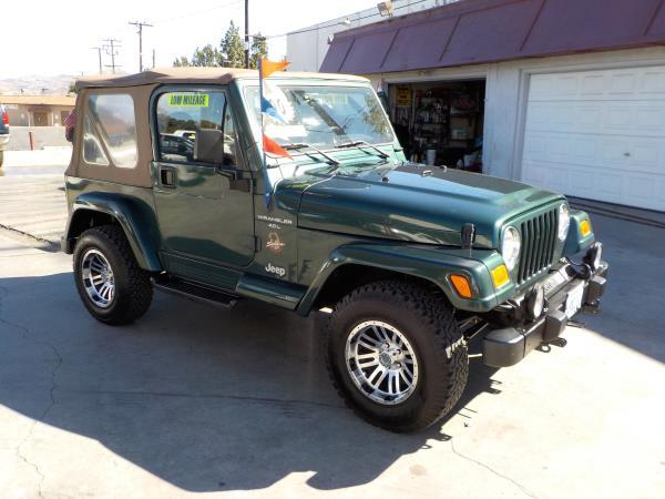 2000 JEEP WRANGLER green 5 speed air conditioneralarmamfm radiocd playercruise controldriv