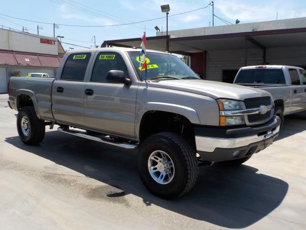 2003 CHEVROLET SILVERADO 1500HD CREW 4WD pewtertan automatic air conditioneralarmamfm radio