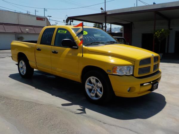 2005 DODGE RAM PICKUP 1500 QUAD yellowcharcole automatic air conditioneralarmamfm radioanti