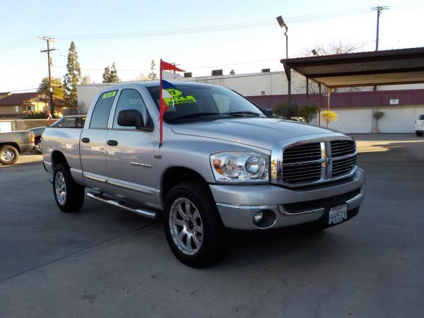 2007 DODGE RAM PICKUP 1500 QUAD CAB silvertan auto air conditioneralarmamfm radioanti-lock