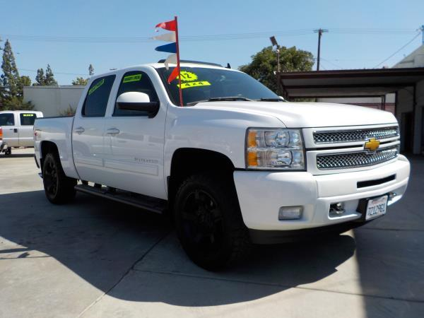 2012 CHEVROLET SILVERADO 1500 CREW 4WD whiteblack automatic air conditioneralarmamfm radioa