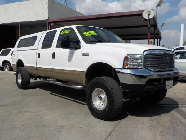 2001 FORD F-250 whitetan auto 400750 miles Stock 8618 VIN 1FTNW21F41EA31274 Call now for m