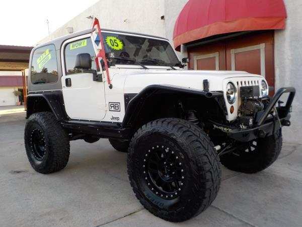 2005 JEEP WRANGLER whitetan clth automatic air conditioneramfm radioanti-lock brakescd play