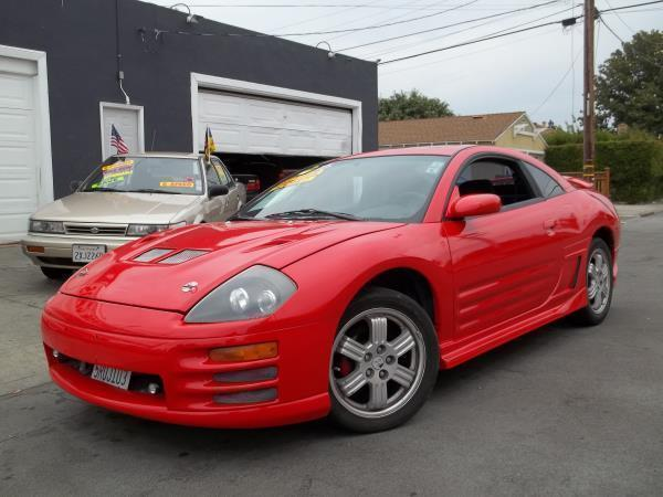 2000 MITSUBISHI ECLIPSE redblack 5 speed automatic air conditioneralarmamfm radioanti-lock