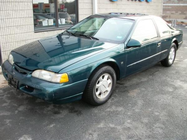 1995 FORD THUNDERBIRD greencharcoal automatic air conditioneralarmamfm radioanti-lock brake