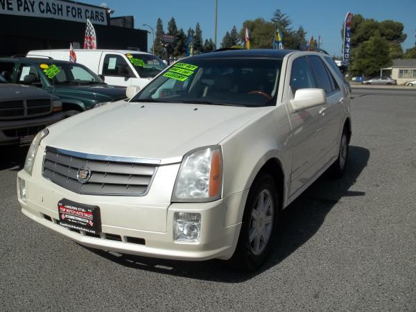 2004 CADILLAC SRX whitetan automatic air conditioneramfm radioanti-lock brakescd playerchi