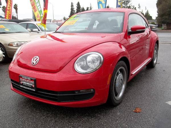 2012 VOLKSWAGEN BEETLE redblack 6 speed automatic air conditioneralarmamfm radioanti-lock b