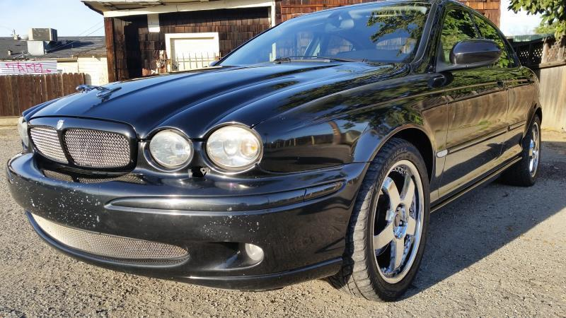 2002 JAGUAR X-TYPE blackblack 5 speed manual air conditioneralarmamfm radioanti-lock brakes