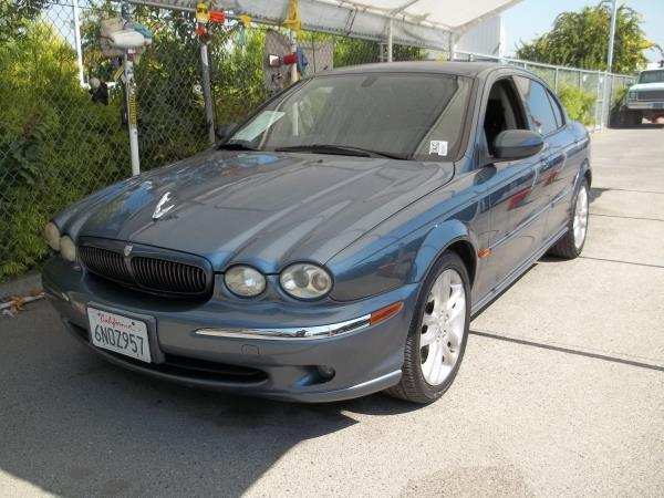 2002 JAGUAR X-TYPE blueblack 5 speed automatic air conditioneralarmamfm radioanti-lock brak