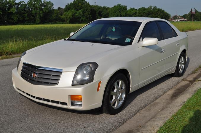2005 CADILLAC CTS whitetan automatic air conditioneralarmanti-lock brakescd changerchild-sa
