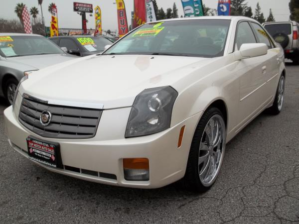 2005 CADILLAC CTS whitetan automatic air conditioneralarmamfm radioanti-lock brakescassett